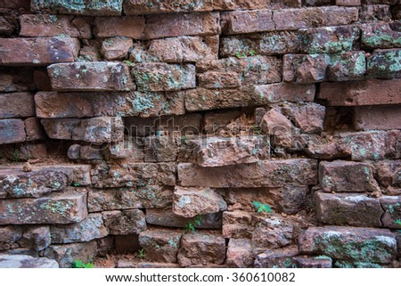 Old and broken red stone brick wall, close up details background, High definition - stock photo