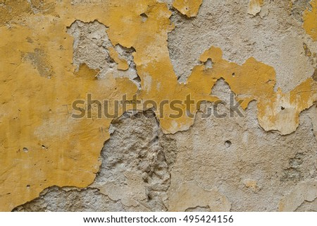 old  and damaged yellow wall background