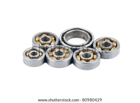 Old and dirty ball ball bearing, isolated on white background - stock photo