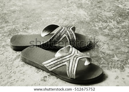 old and dirty flip flops - black and white