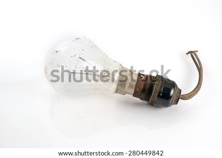 Old and dirty light bulb on white background.