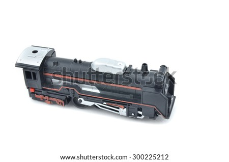 old and dusty look toy train head with red stripe form left to right view isolated white background - stock photo