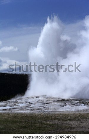 Old and faithful geyser at Yellowstone national park, USA - stock photo