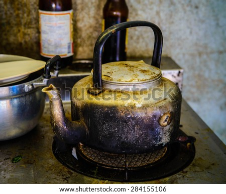 Old and grunge kettle, Old black kettle in the kitchen,stillife - stock photo