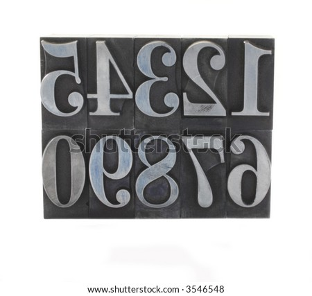 old and inkstained numbers in letterpress lead type - stock photo