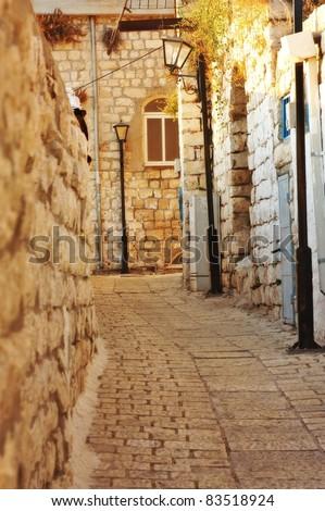old and narrow Mediterranean street - stock photo