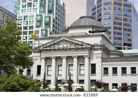 old and new buildings in vancouver - domed structure in front of high-risers