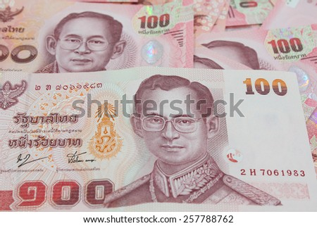 Old and New versions of hundred Thai bank notes
