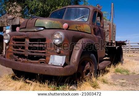 Old and rusted truck left on a farm - stock photo