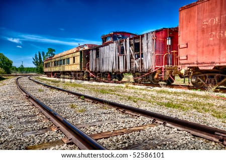 Old and rusted wagon trains over a railway. - stock photo