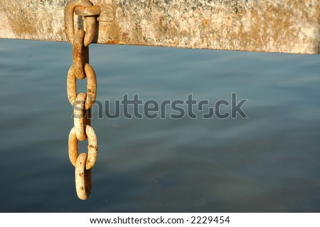 old and rusty chain, detail of industrial construction on the river banks - stock photo