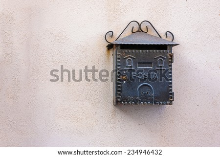 Old and rusty postbox on the pink wall - stock photo