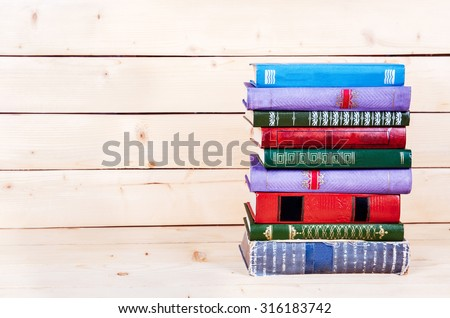 Old and used hardback books or text books seen from above - stock photo