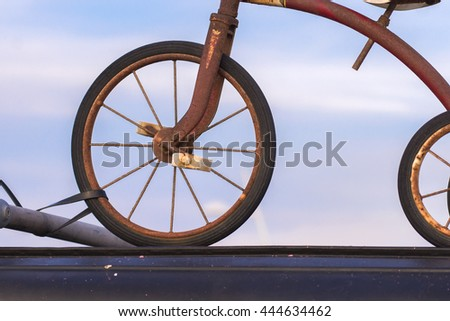 old and vintage bicycle and sky on background. (leave space for adding your content)