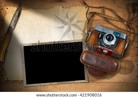 Old and vintage camera with leather case, empty parchment, photo frame and a pen knife. Template for adventurous travels - stock photo