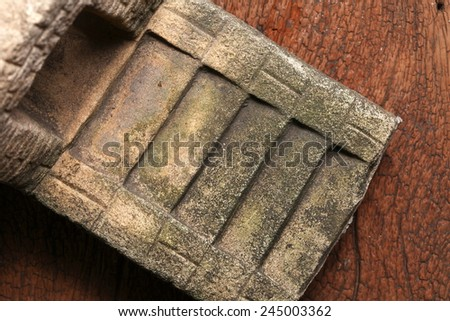 Old and vintage surface texture of sand stone pavilion stair architectural sculpture model with moss stain represent the texture and surface background. - stock photo