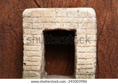 Old and vintage surface texture of sand stone pavilion wall and window architectural sculpture model with moss stain represent the texture and surface background. - stock photo