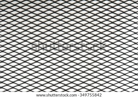 old and weathered metal net with rust  isolated on white background - stock photo