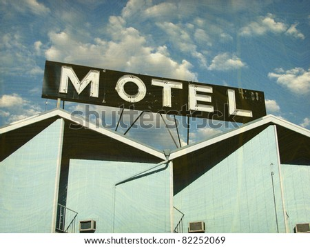 old and worn vintage photo of motel building and sign - stock photo