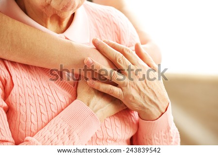 Old and young hands hug, closeup - stock photo
