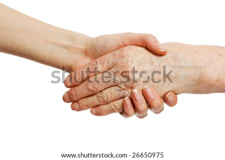 old and young hands; offering comfort and assistance - stock photo