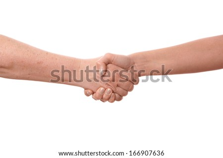 old and young woman shaking hands