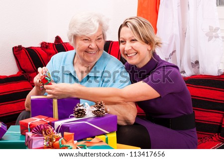 old and young woman with gifts