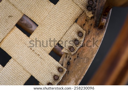 Old antique arm chair with inlays for wood repair and upholstery restoration - stock photo