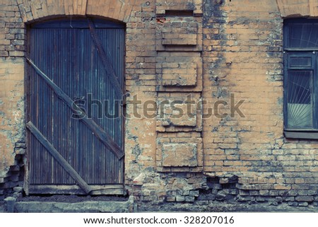 Old antique building wall with big door and window. Vintage effect.  - stock photo