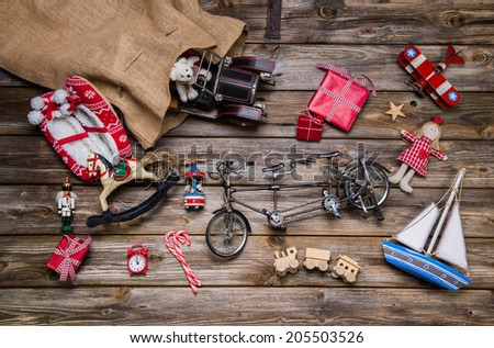 Old antique children toys - decoration for christmas on wood. - stock photo