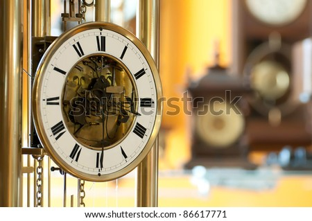 Old antique clocks close up and blurred background clocks - stock photo