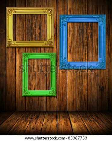 Old antique colorful frame on wood wall room background - stock photo