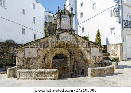 Old antique fountain dates back to 1548 in Mondonedo, Lugo Spain - stock photo