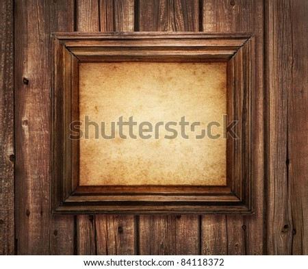 old antique frame over grungy background - stock photo