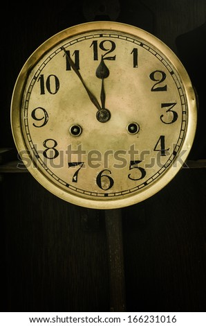 old antique golden dial clock - stock photo