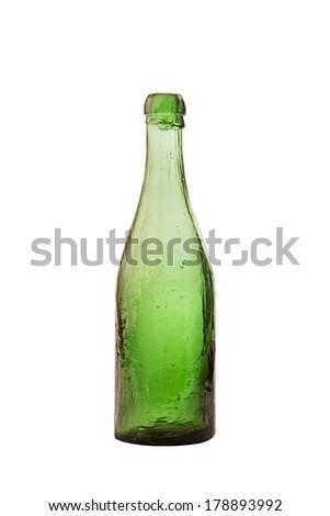 Old antique green transparent bottle - stock photo
