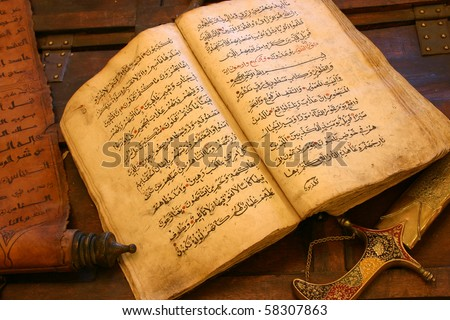 Old Antique Handwritten Qura'an, with a leather message & Sword - stock photo