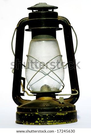 old antique oil lantern in white isolated - stock photo