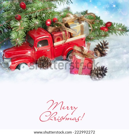 Old antique toy truck carrying a Christmas gift box. - stock photo