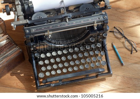 Old Antique Typewriter on a Wood Counter - stock photo