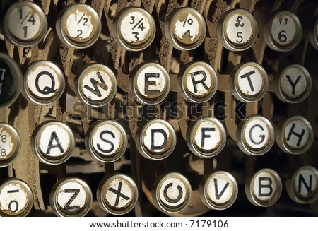 Old, antique, very dusty typewriter keys