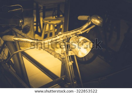 Old antique vintage bicycle - vintage effect style pictures (Dark tone color), selective focus point