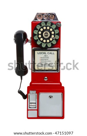 Old, antique, vintage red pay phone isolated over white - stock photo