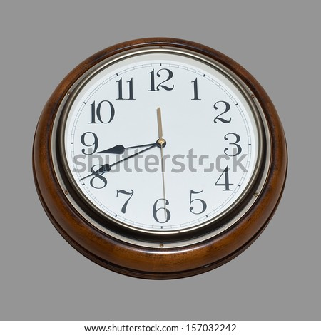 Old antique wall clock  isolated on gray background. - stock photo