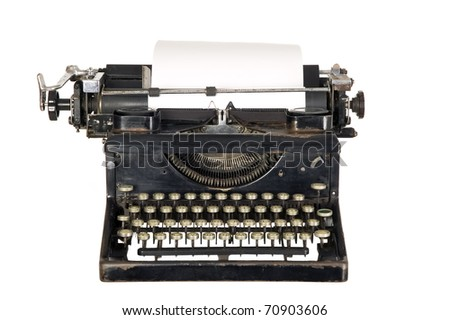 Old antique white typewriter with black keys