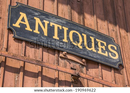 Old antiques sign of a shop in Lubeck, Germany - stock photo