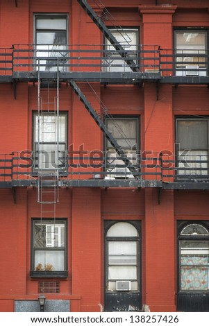 Old apartment building with fire escapes, Manhattan, New York City - stock photo