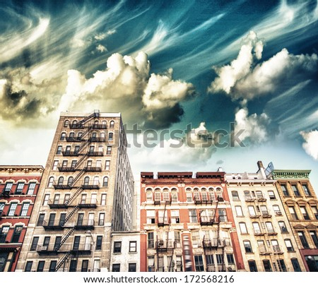 Old apartment buildings in Greenwich Village with external stairs, Manhattan, New York City. - stock photo