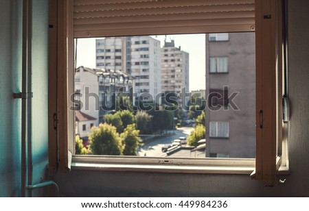 Old apartment interior, view through open window, details of a city life.