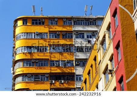 Old apartments in Hong Kong downtown at day  - stock photo